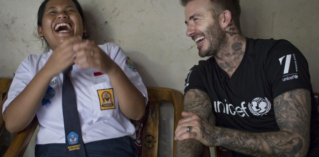 Unicef Goodwill Ambassador David Beckham smiles with  Sripun, 15, at her home in Semarang, Indonesia